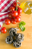 Tagliatelle pasta with tomato and basil leaf Stock Image