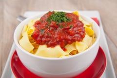 Tagliatelle pasta with tomato sauce Stock Photos