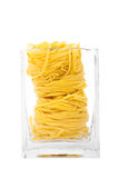 Tagliatelle pasta in a transparent jar isolated on white backgro Royalty Free Stock Photography
