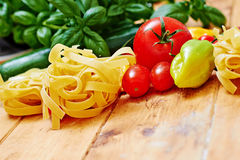 Tagliatelle pasta and vegetables on table Stock Image