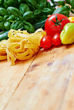 Tagliatelle pasta and vegetables on table Royalty Free Stock Images