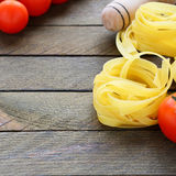 Tagliatelle pasta on the wooden background Royalty Free Stock Image