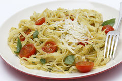 Tagliatelle with pesto tomatoes and fork Royalty Free Stock Image
