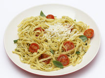 Tagliatelle with pesto and tomatoes Royalty Free Stock Photos