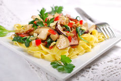 Tagliatelle with porcini mushrooms and spinach Stock Photo