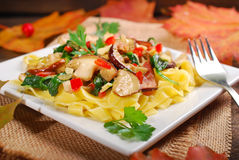 Tagliatelle with porcini mushrooms and spinach Stock Photos