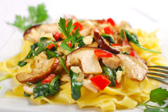Tagliatelle with porcini mushrooms and spinach Stock Image