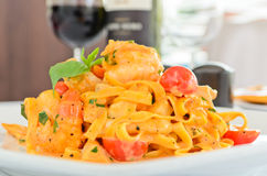 Tagliatelle with prawns and tomatoes Royalty Free Stock Photography