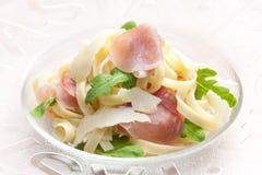 Tagliatelle. With ruccolla and prosciutto Stock Images
