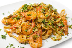 Tagliatelle with shrimps Stock Photo