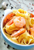 Tagliatelle with shrimps in a bowl Stock Images
