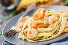 Tagliatelle with shrimps and parsley Royalty Free Stock Photo