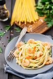 Tagliatelle with shrimps and parsley Stock Photos