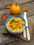 Tagliatelle, spaghetti with chicken with pumpkin s Stock Photo