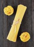 Tagliatelle and spaghetti italian pasta Stock Images