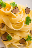 Tagliatelle with summer truffle Stock Photos
