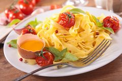 Tagliatelle with tomato and basil Royalty Free Stock Image