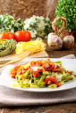 Tagliatelle with tomato, mozzarella and bacon Royalty Free Stock Photos