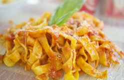 Tagliatelle with tomato sauce Stock Photos
