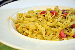 Tagliatelle with Tomatoes and herbs. A plate of delicious pasta with fresh tomatoes and herbs stock photos