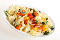 Tagliatelle and tomatoes slanted Royalty Free Stock Images