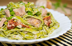 Tagliatelle with tuna and dried tomatoes Royalty Free Stock Images