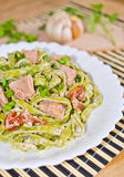 Tagliatelle with tuna and dried tomatoes Royalty Free Stock Photo
