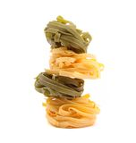 Tagliatelle in two colours, close-up. On the white background Stock Photography