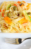 Tagliatelle and veg vertical Stock Photography