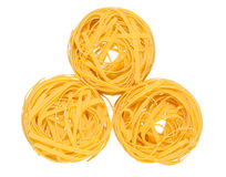 Tagliatelle on white. Tagliatelle pasta on isolated background Royalty Free Stock Image