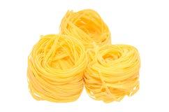 Tagliatelle on white. Tagliatelle pasta on isolated background Stock Photo
