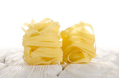 Tagliatelle on a white table Royalty Free Stock Photo