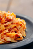 Tagliatelle With Tomato Sauce In Wooden Plate Royalty Free Stock Image