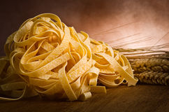 Tagliatelle on wood Stock Photo