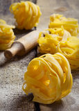 Tagliatelle. On a wooden table Stock Images
