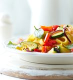 Tagliatelle with zucchini, pepper and red onion Royalty Free Stock Images