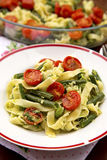Tagliatelles with Vegetables. Tagliatelles with green beans and cherry tomatoes Stock Photos