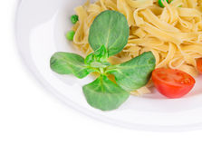 Tagliatelli pasta with tomatoes and basil. Stock Photo