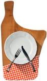 Tagliere con il piatto e la coltelleria Immagini Stock Libere da Diritti