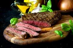 Tagliere raro affettato del coltello della forcella della bistecca Immagini Stock