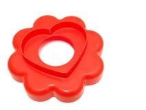 Taglierina del biscotto del cuore. Fotografia Stock
