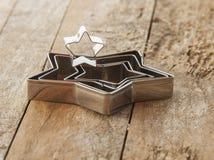 taglierina del biscotto di Natale della stella Fotografie Stock