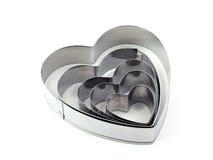 Taglierina a forma di dei biscotti del cuore fotografie stock