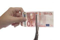 Taglio dei soldi Immagine Stock