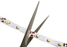 Taglio del nastro della luce del LED all'indicato a dalle icone di forbici Fotografia Stock