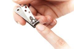 Taglio delle sue unghie del dito Immagini Stock Libere da Diritti