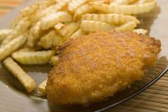 Taglio e patate fritte Fotografie Stock