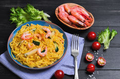 Tagliolini Pasta spaghetti with shrimps and vegetables stock photography