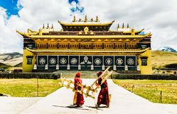 Tagong, China on 12th May 2015 - Gyergo monastery and Mount Yala by tagong grassland in Sichuan province royalty free stock photography