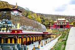 Tagong village Heping Fahui, China on 12th May 2015 - View on tibetan monastery and prayer wheels royalty free stock image